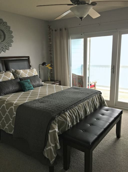 Relaxing bedroom suite with queen sized bed. Direct view of the Bay!