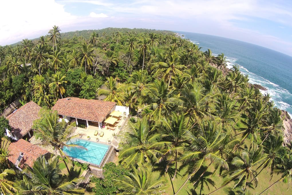 Aerial View; The villa and coconut plantation, looking east