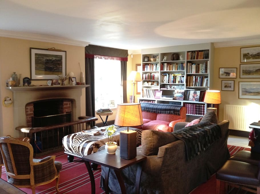 Relax in our lovely comfortable sitting room - even nicer when the log fire is blazing!