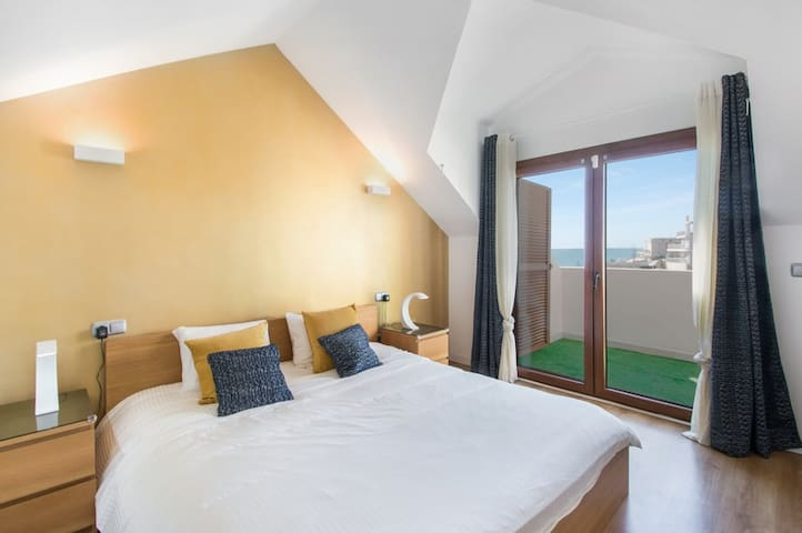Master bedroom with sea views.