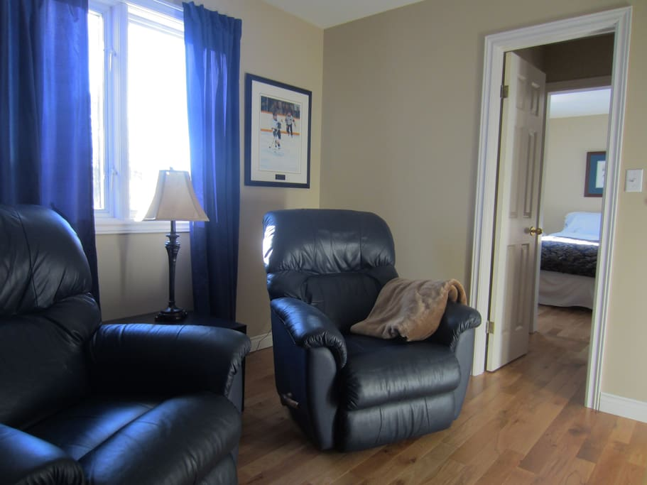 Two comfy Lazy-boy recliners in the sitting room