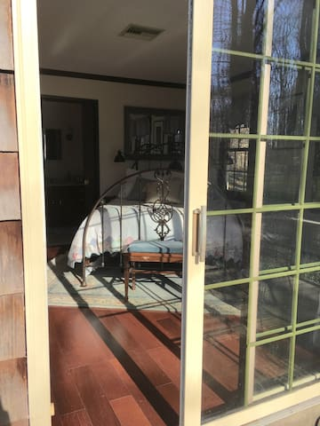 Private entrance from the deck/ Airbnb bedroom suite is a NO CAT ZONE!   Cats are present in the rest of the house and the yard in warm weather.