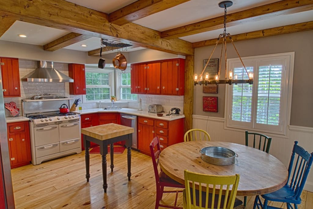 Kitchen with all new appliances, classic antique stove/oven.  All the equipment needed to entertain.