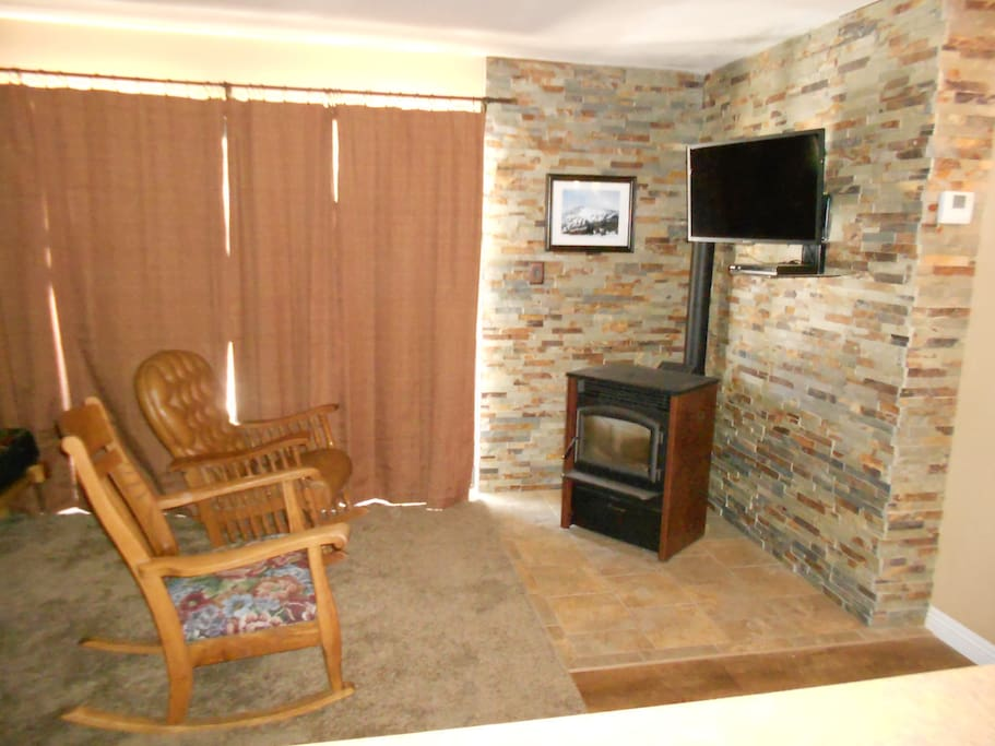 Living room with HD TV with blue ray.  Pellet stove keeps it toasty.