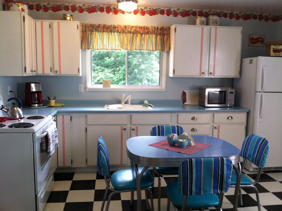 has a fully out-fitted kitchen with 50s Arborite dinette