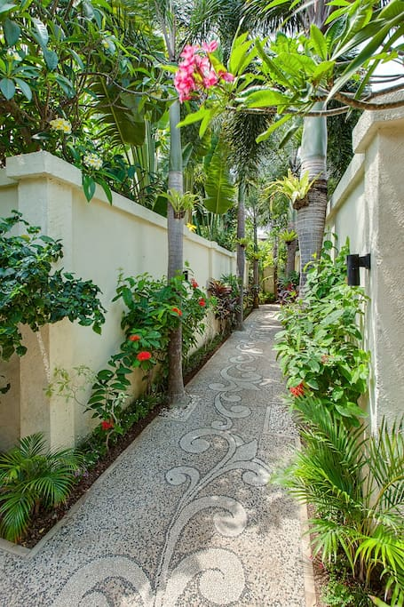 Blooming walkway to the villa