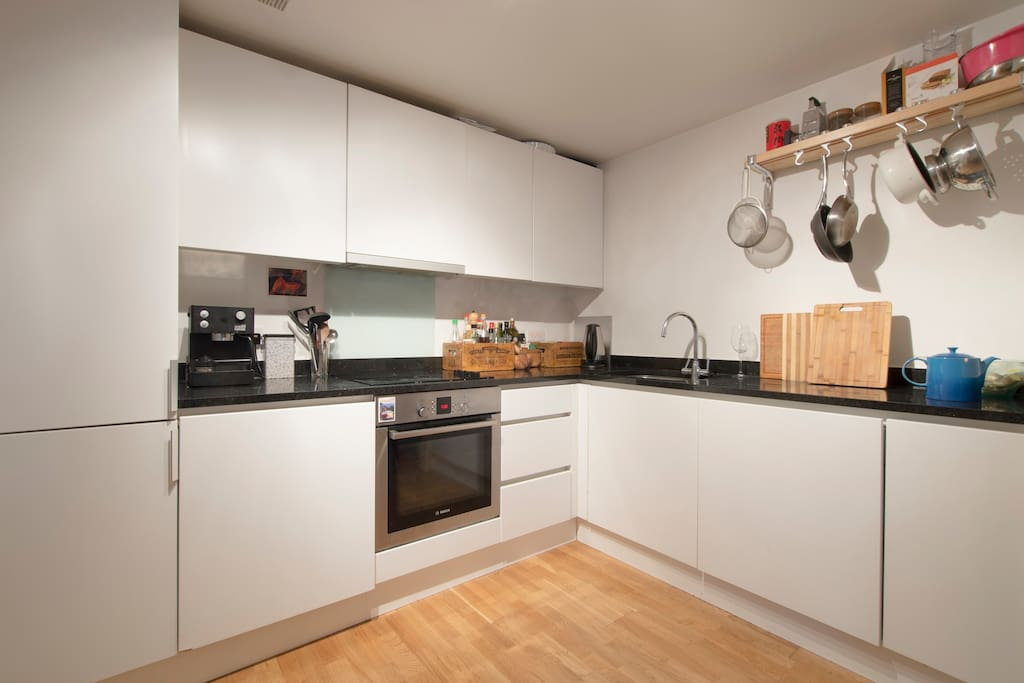 Fully equipped kitchen includes oven, electric hob and dishwasher