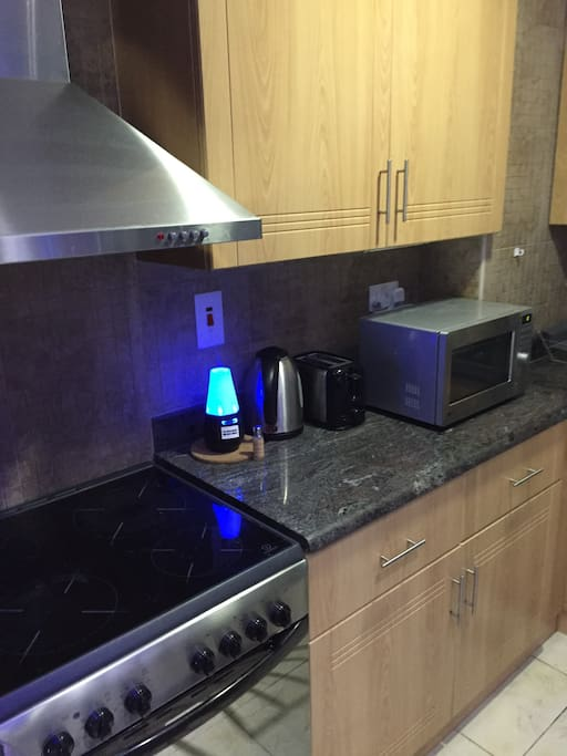 Kitchen - cooker microwave kettle air freshener cupboards