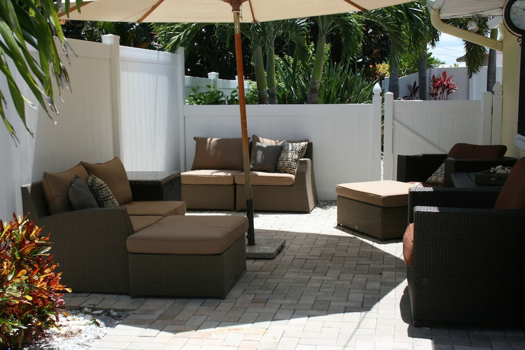 Shaded lounge area next to the pool.