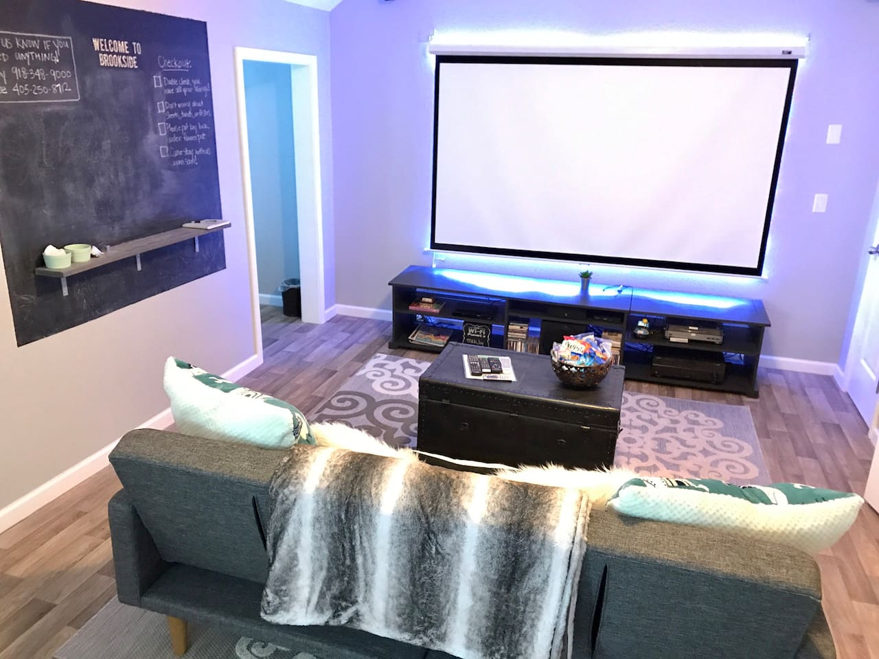 Enjoy the comfy couch with projector and surround sound. You can watch Netflix, Amazon Prime, something from our DVD collection, or stream from your iPhone! Free wifi.