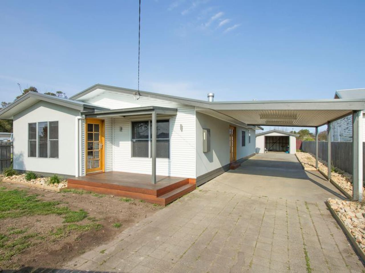 FRONT OF HOUSE AND CARPORT