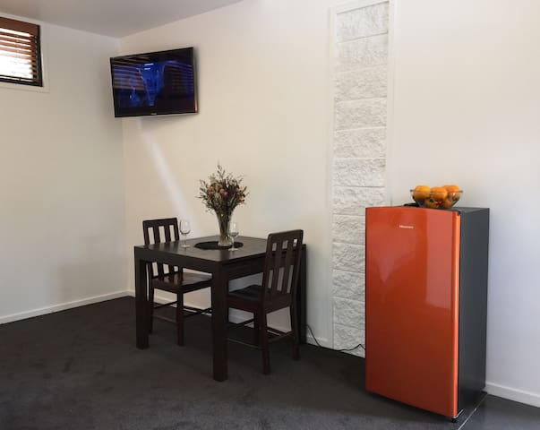 TV, dining table & fridge for all your goodies.