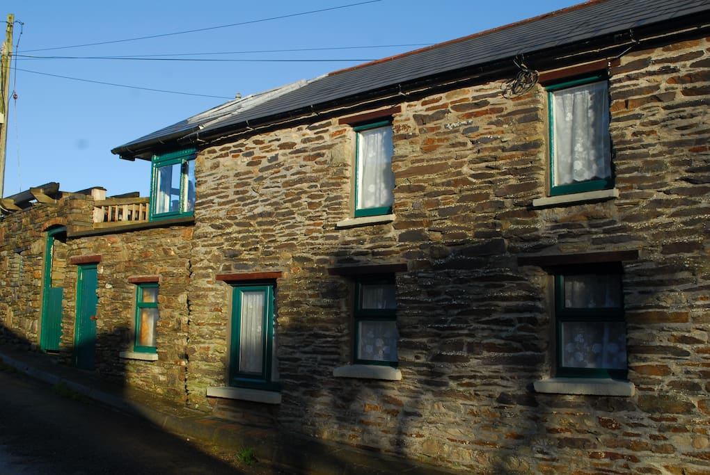 The cottage has living accommodation upstairs and two compact double bedrooms downstairs.