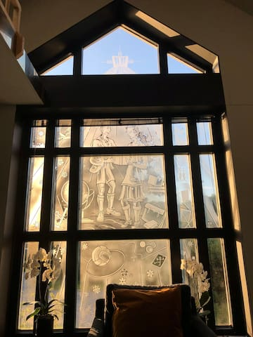 The old window of the elementary School, located in the former liberary of  school with the bible  rising to the sky