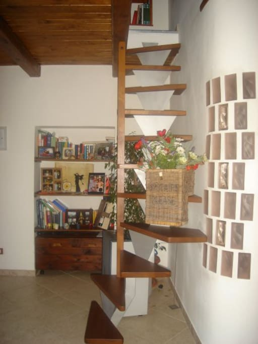 the stairs from the sitting room to the bedroom under the roof