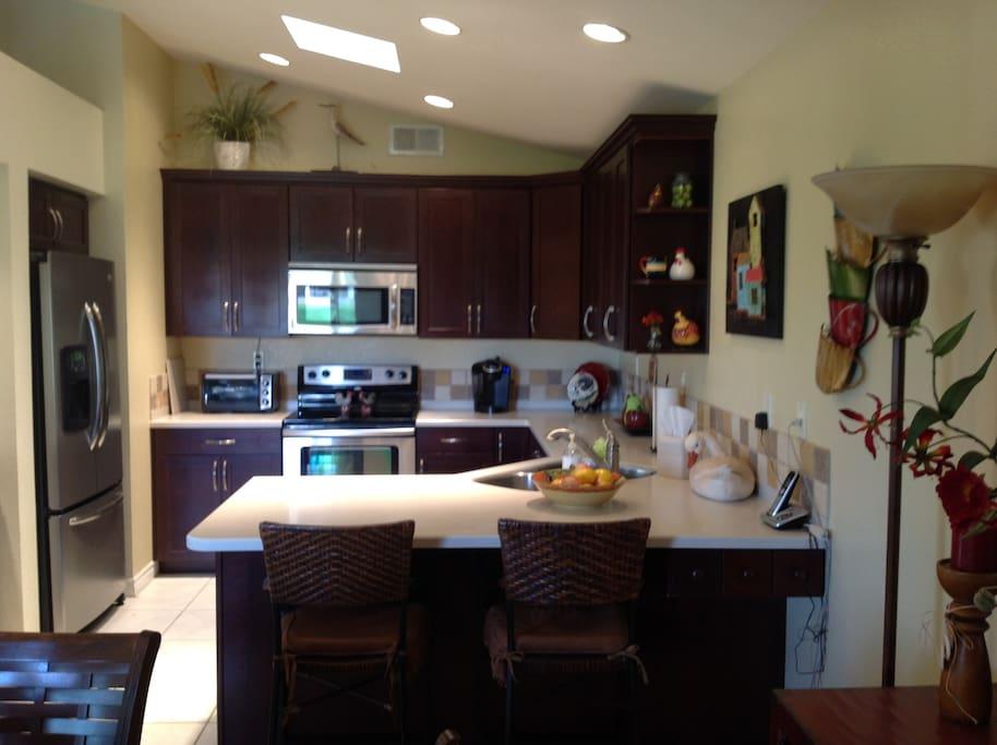 Gourmet kitchen with wet bar