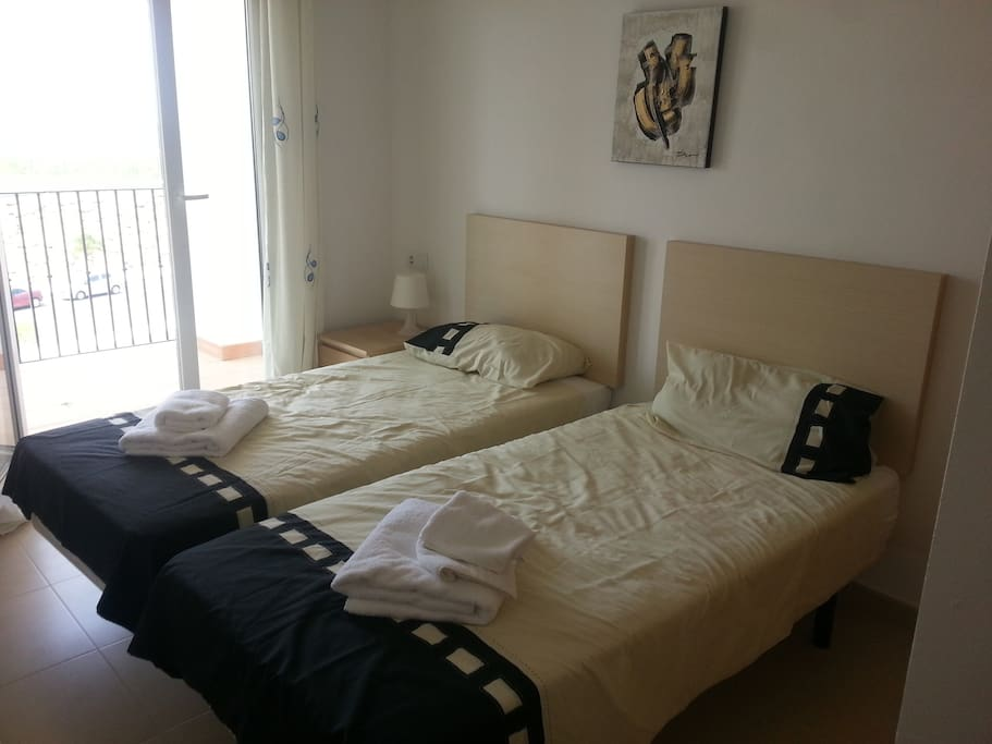 Bedroom B with double bed or 2 x single beds and juliette balcony