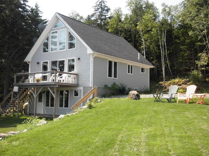 Pretty, modern oceanfront cottage.