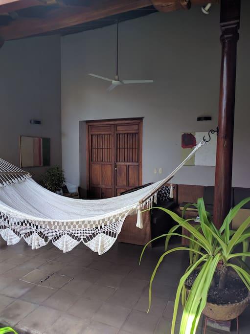 Big comfortable hammock for lounging near pool.
