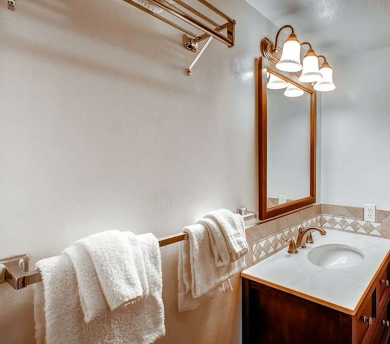 Full size bathroom, with towels and hand soap provided.