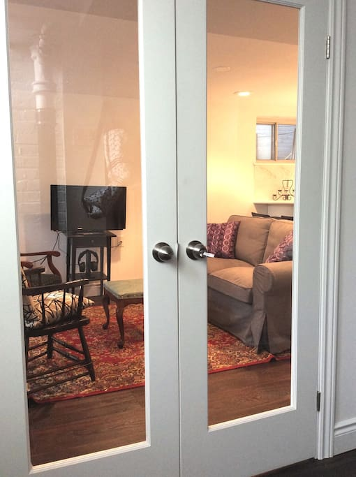 Private entrance with French Doors.