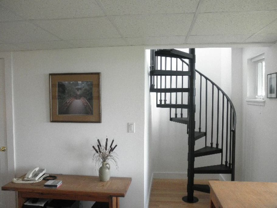 Stairs to downstairs bedroom