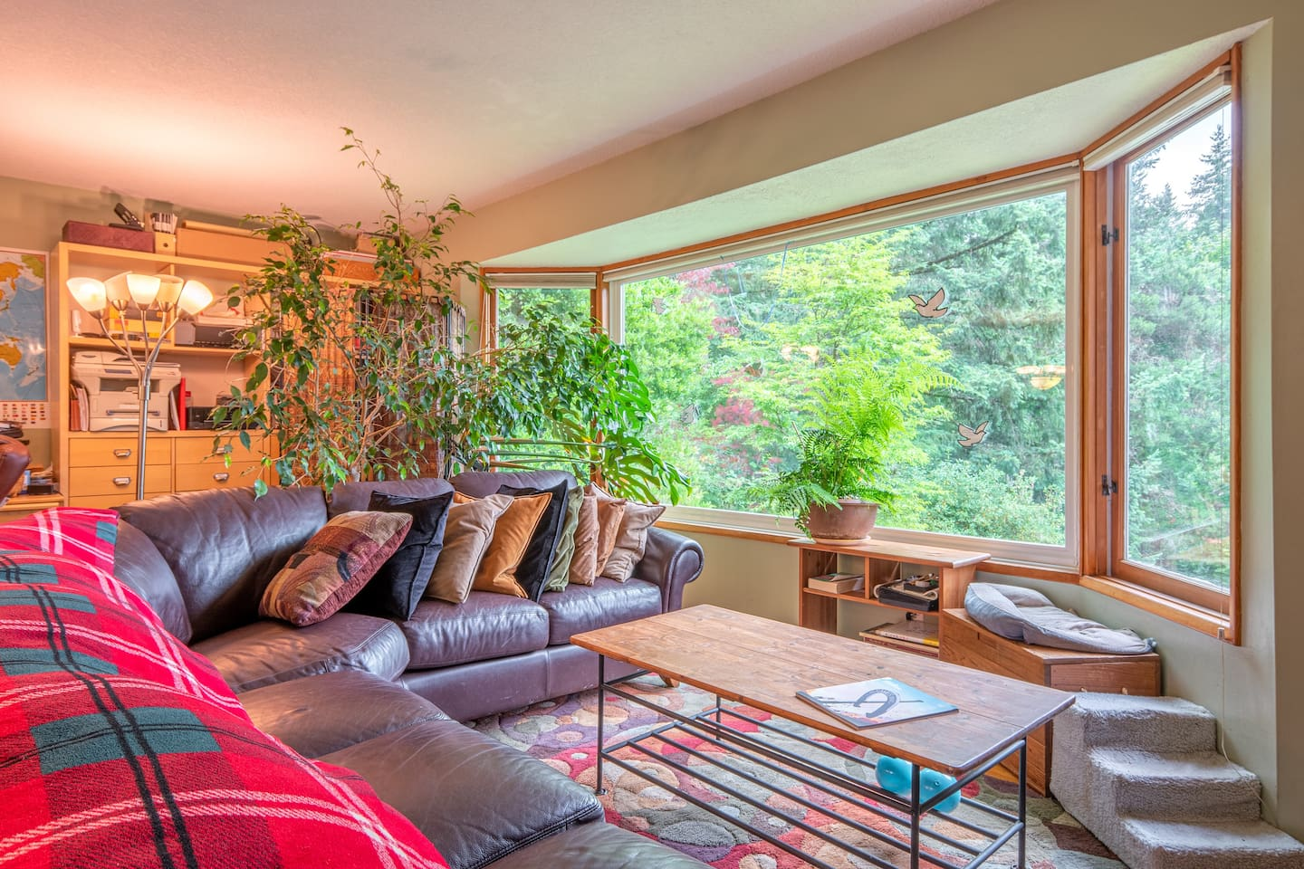 The huge picture window in the living room has more than 45 square feet of glass overlooking a beautiful forested neighborhood. From every window in the house, the view is filled with trees.