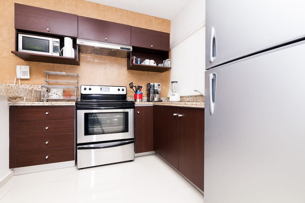 Fully equipped kitchen with a coffee machine