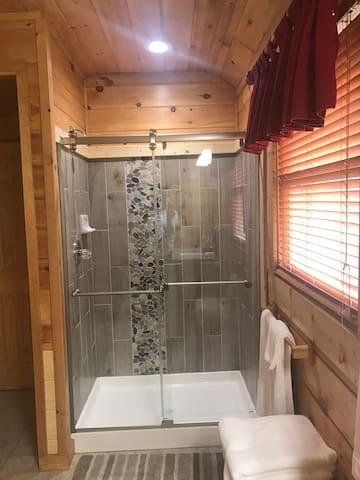 New designer shower with glass doors.