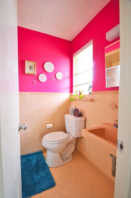pink powder room in bedroom with a stand-up shower.