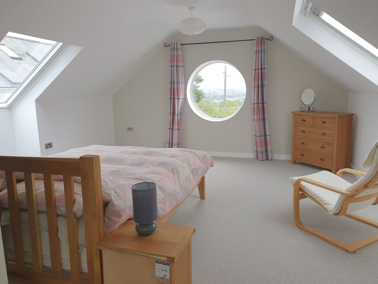 Spacious and luxurious bedroom with breathtaking views over Pembroke castle and the surrounding countryside