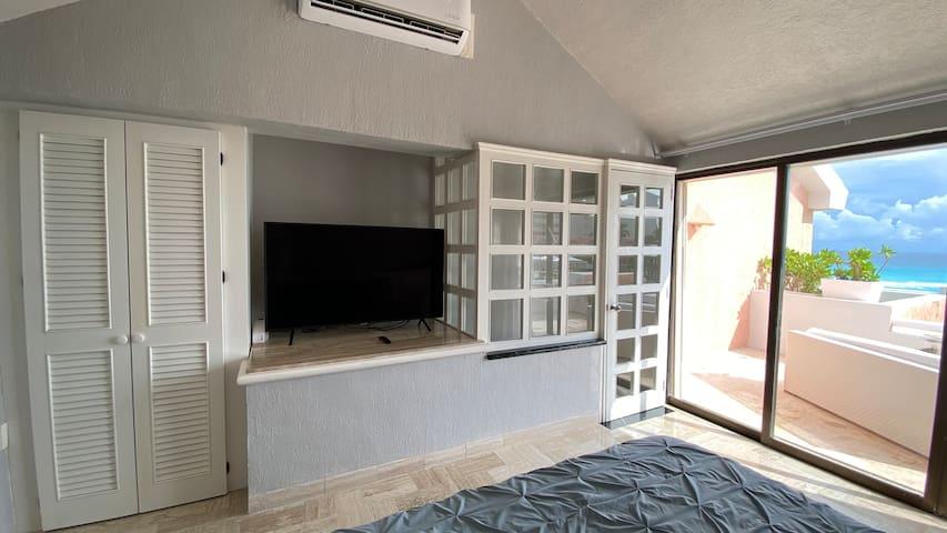 master bedroom with terrace overlooking the ocean