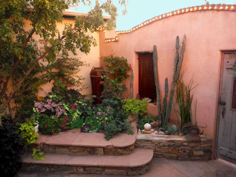 Private, high-walled courtyard with fountain..south and east exposure is perfect.