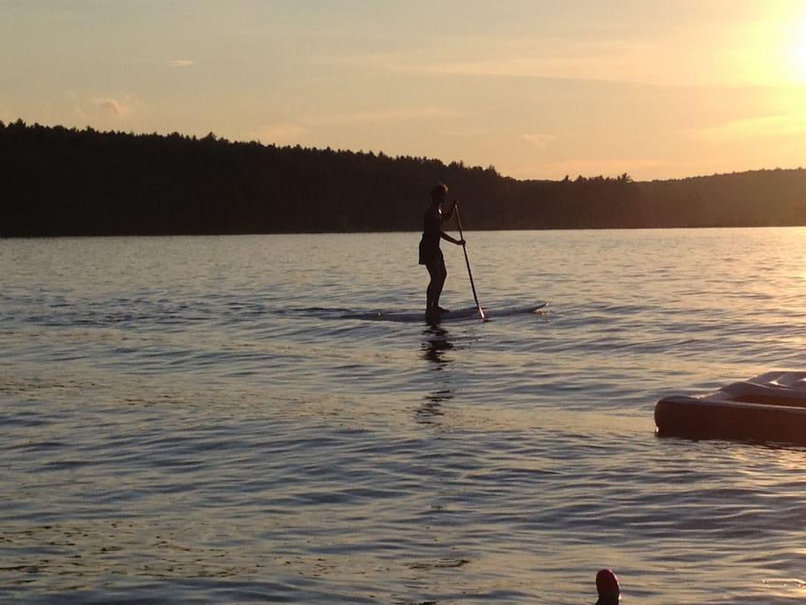 Paddle board or float on the swim platform