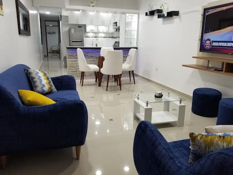 Beautiful and spacious premiere apartment on the third floor,  fully equipped with everything you need for your stay.  Excellent location 10 minutes from the Airport, ground terminal and all shopping centers.