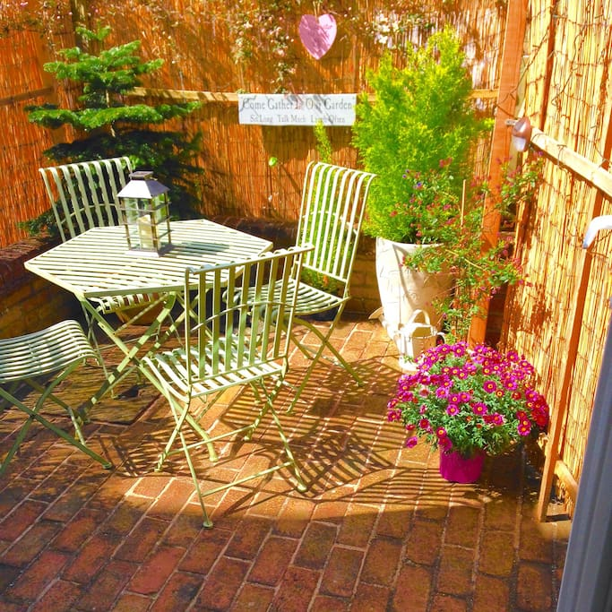 Sunny private brick paved courtyard area off the kitchen, perfect for evening drinks!