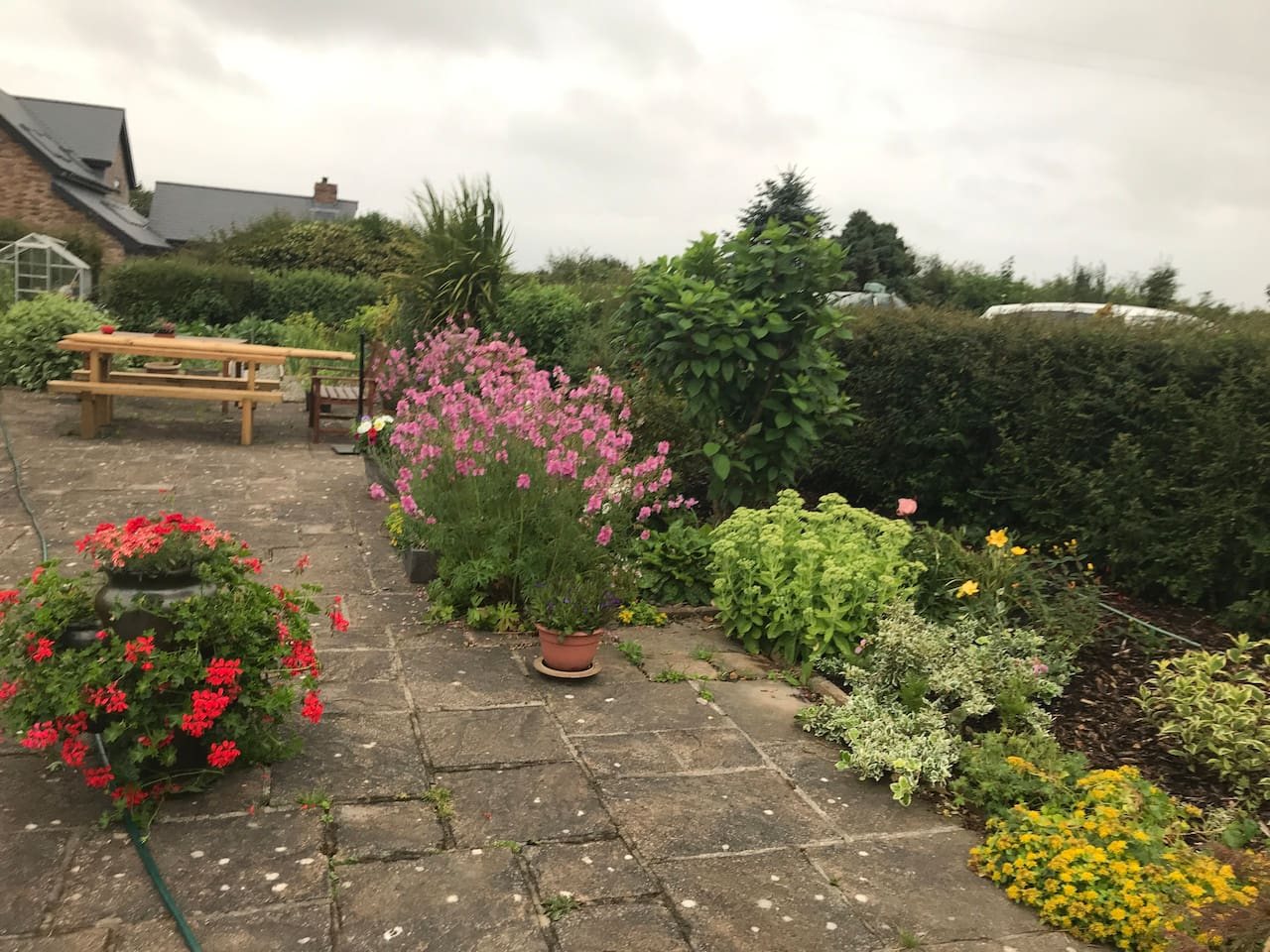 The garden has tables and benches and is a space guests can use, weather permitting.