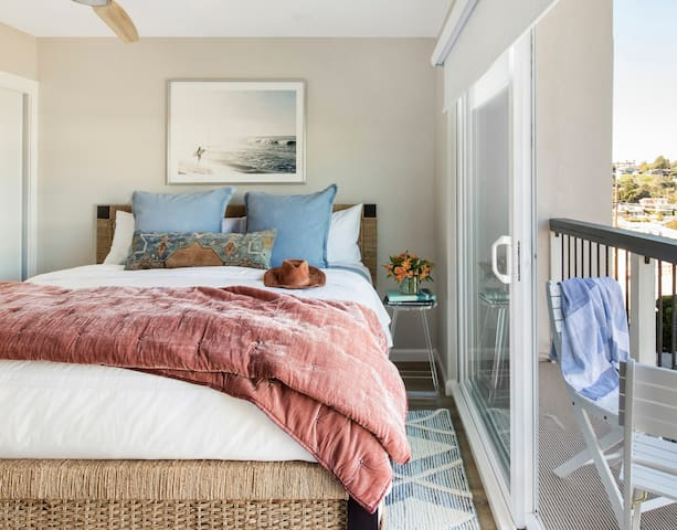 Second master retreat on the main level for two families to travel in comfort. The downstairs master retreat with King Bed, smart TV, attached private en suite bath, and a sliding glass door to small front balcony.  Private space for remote learning.