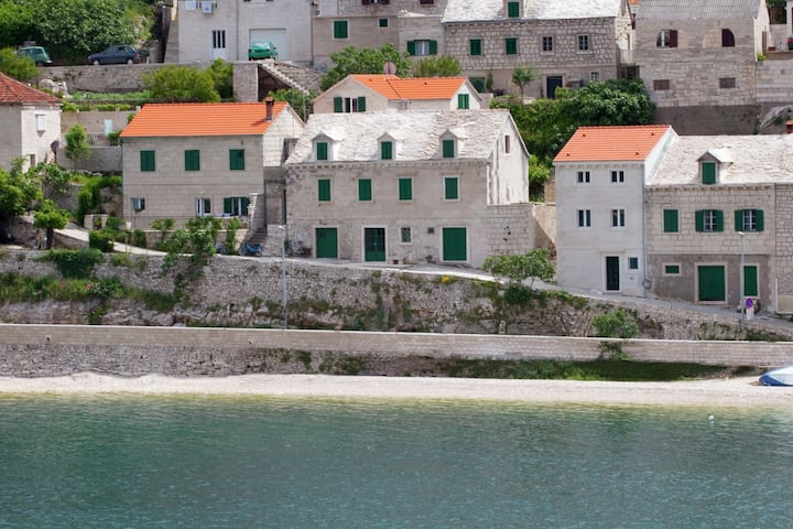 Beautiful holiday home on the island Brac, with the sea and a small beach in front of the door!