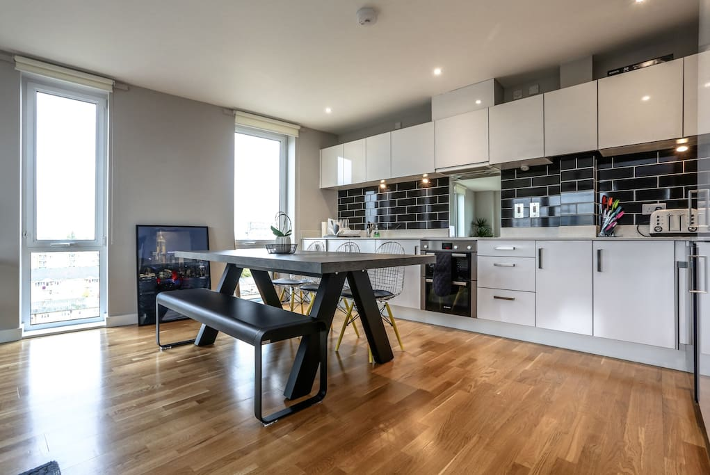 Open plan kitchen with large dining table