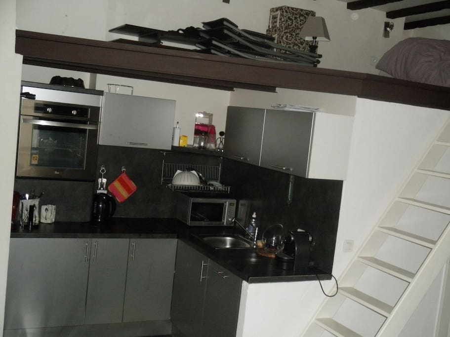 Kitchen and stair to the mezzanine