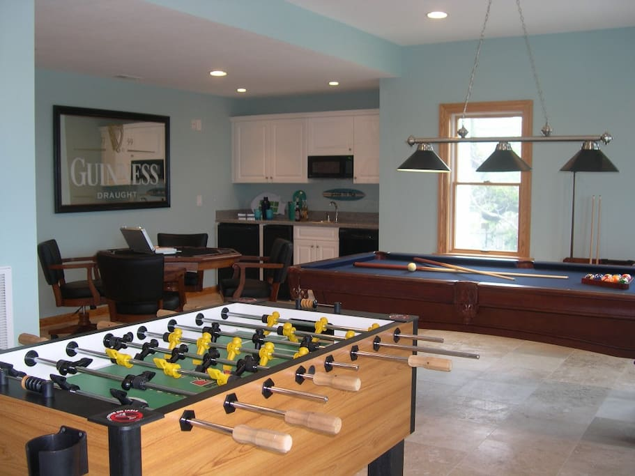 Game room with pool table, foosball, card table, wet bar