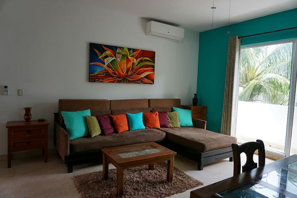 Living Room With Slider to Rear Balcony and Flat Screen TV