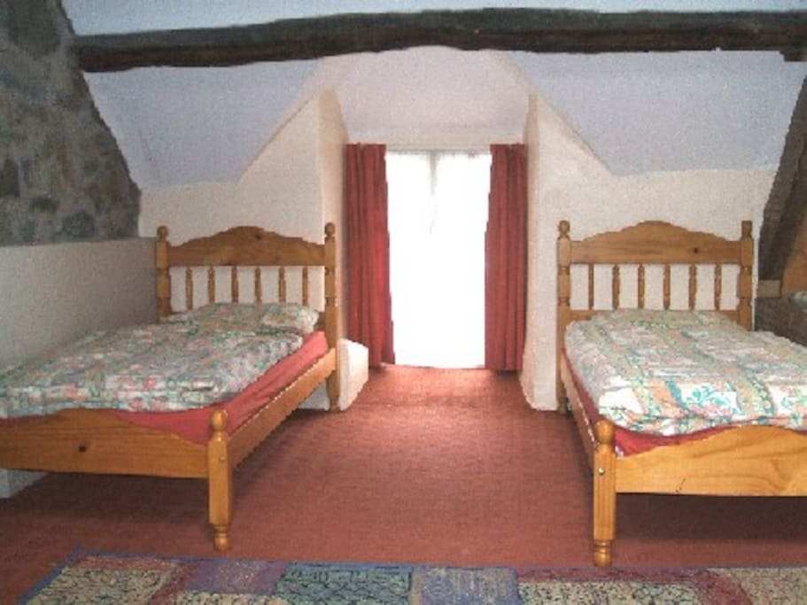 one of the bedrooms (it has 4 single beds)