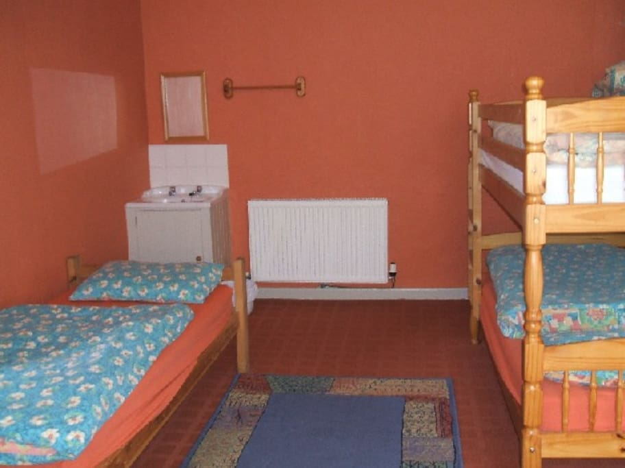 one of the bedrooms (it has 2 single beds and 2 bunk beds)