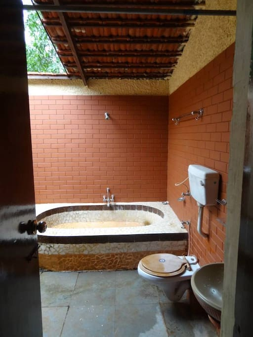 unique open-roof bathroom with tub