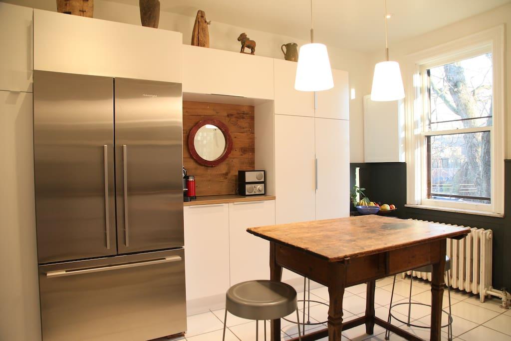 Spacious fridge, Nespresso machine & Tivoli radio in the kitchen