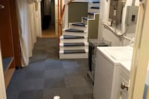 Bright utility area with dedicated washer, dryer and ironing board!