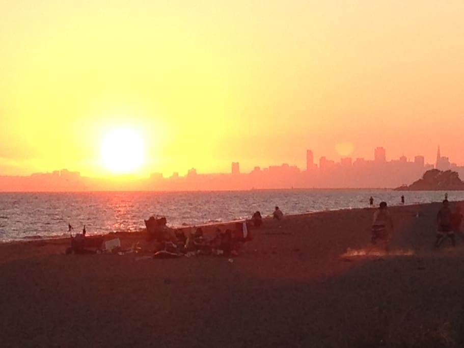 A fall sunset on the beach just across the street from the apartment. The city in the distance is San Francisco.