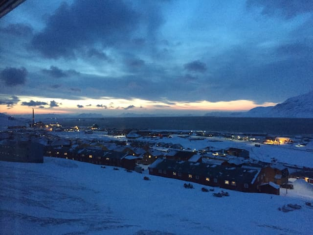 Panorama view from the apartment. Sea side area, and the Isfjord in front. North direction.
